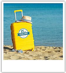 85 Jahre PHILIPPI Koffer am Strand